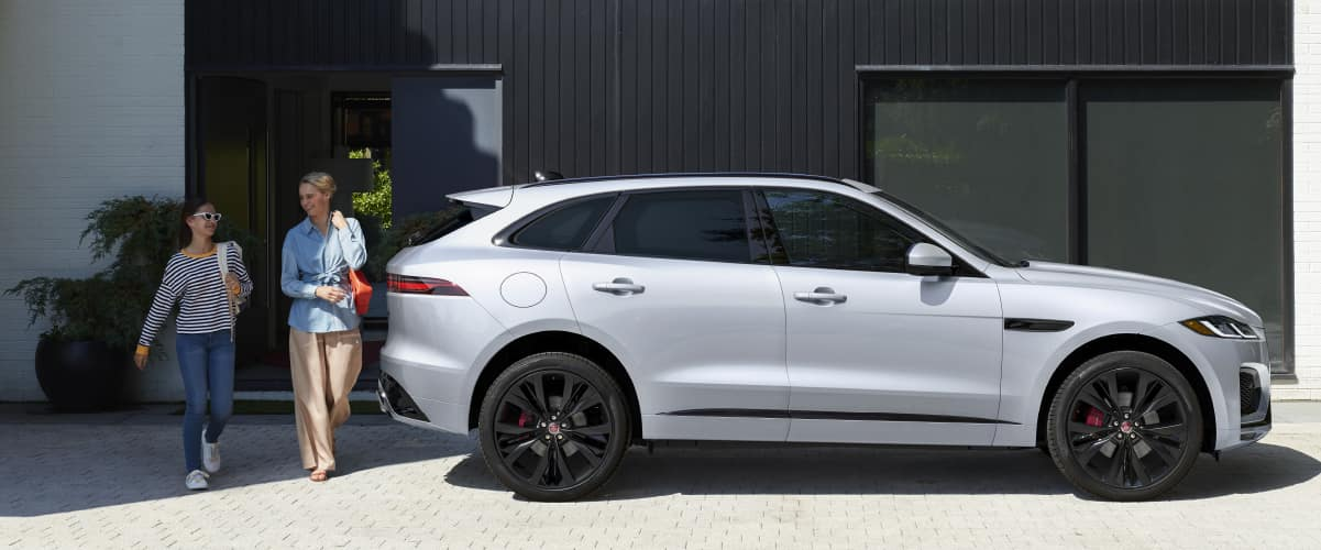 Silver F-PACE parked on driveway.