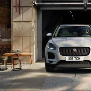 2018 Jaguar E PACE pulling out of parking garage