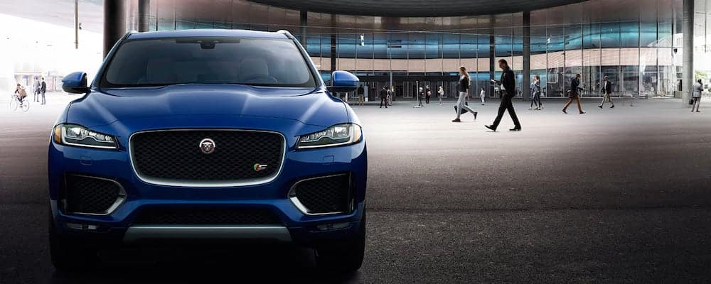 blue 2019 Jaguar F-PACE parked in a large guilding