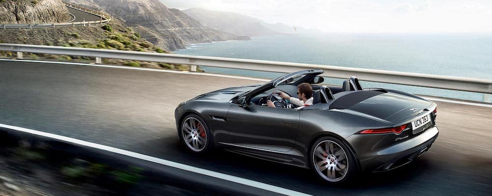 2020 jaguar f-type checkered flag convertible trim in gray driving on coastal highway