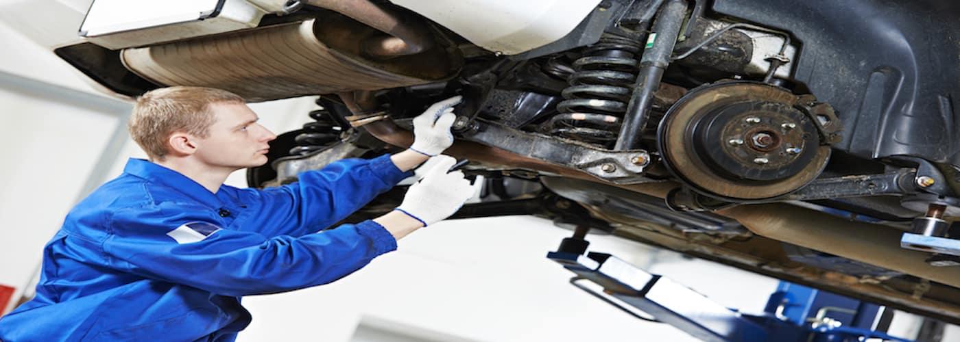 mechanic at work on vehicle suspension
