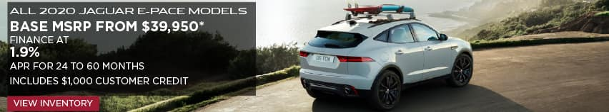 ALL 2020 JAGUAR E-PACE MODELS. BASE MSRP FROM $39,950. FINANCE AT 1.9% APR FOR 24 TO 60 MONTHS. INCLUDES $1,000 CUSTOMER CREDIT. OFFER ENDS 3/31/2020. VIEW INVENTORY. WHITE JAGUAR E-PACE DRIVING DOWN STREET NEAR BEACH.