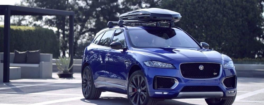 2019 Jaguar F-PACE in blu with roof rack and cargo box