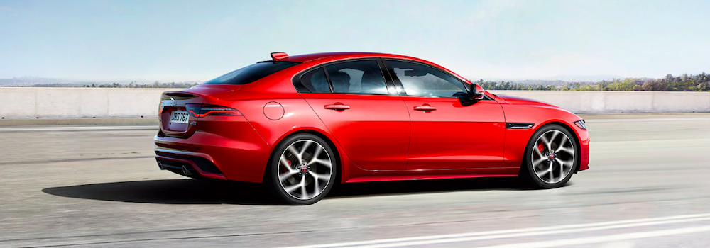 2020 jaguar xe red driving on road