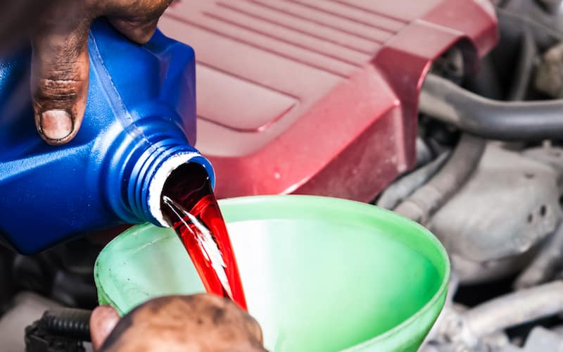 pouring transmission fluid