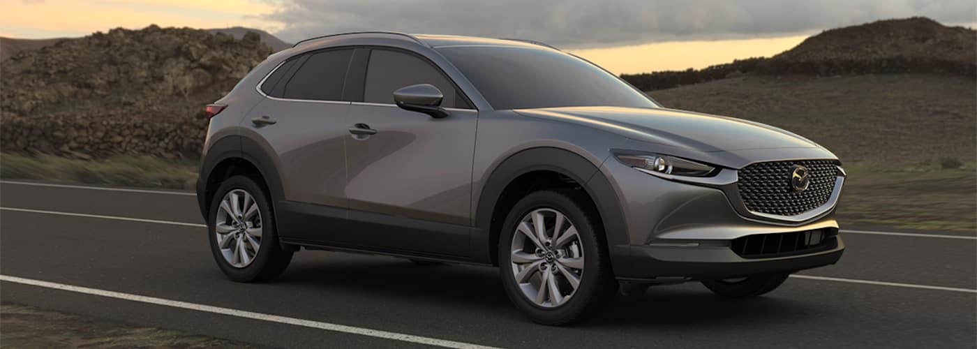 2020 mazda cx-30 silver driving on open road