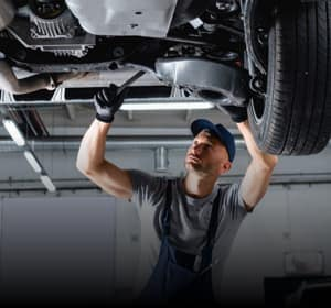 Service technician working under a vehicle