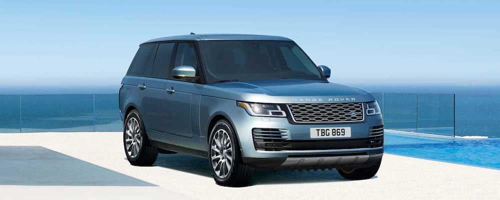 2019-land-rover-range-rover-in-byron-blue parked on concrete in front of ocean