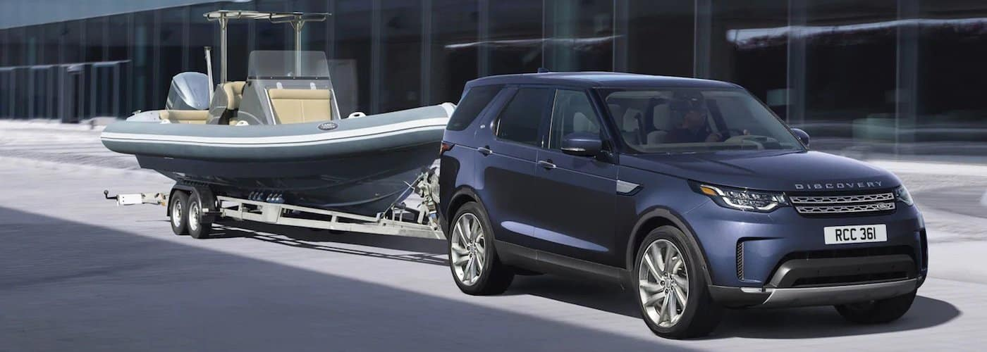 Blue 2020 Land Rover Discovery Towing Boat