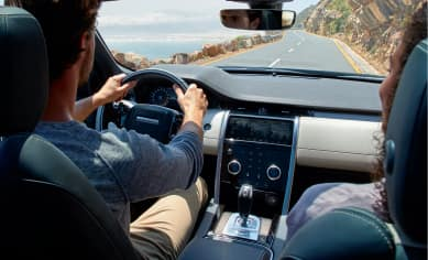 Image featuring two individuals taking a test drive.