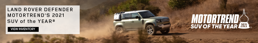 LAND ROVER DEFENDER MOTORTREND'S 2021 SUV OF THE YEAR®. VIEW INVENTORY. SILVER LAND ROVER DEFENDER PARKED IN MOUNTAIN RANGE.