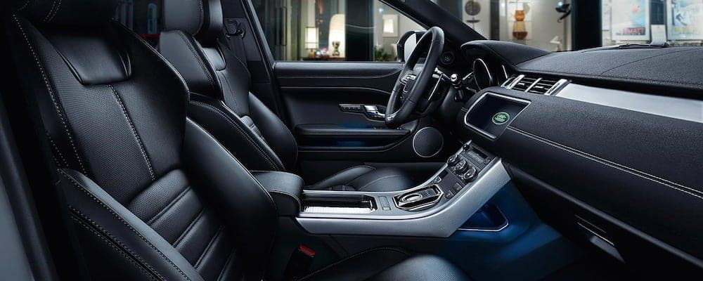 2019 Range Rover Evoque Interior with view of front seats and dashboard in black leather upholstery