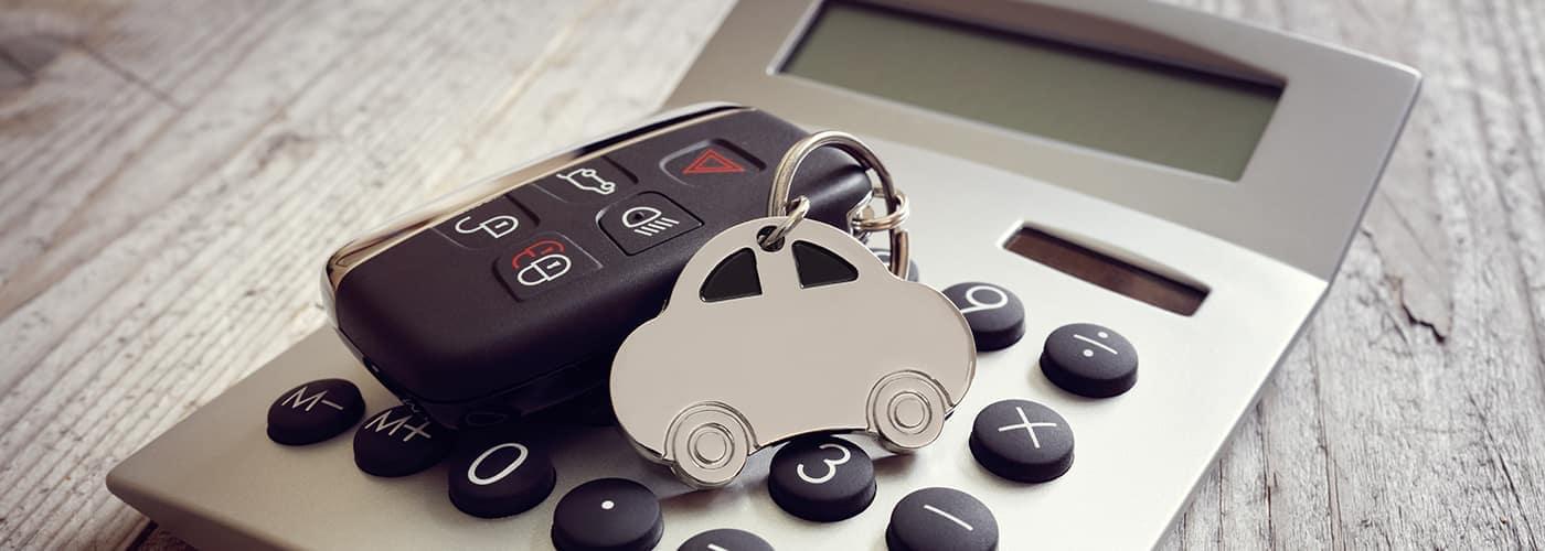 car key on top of calculator