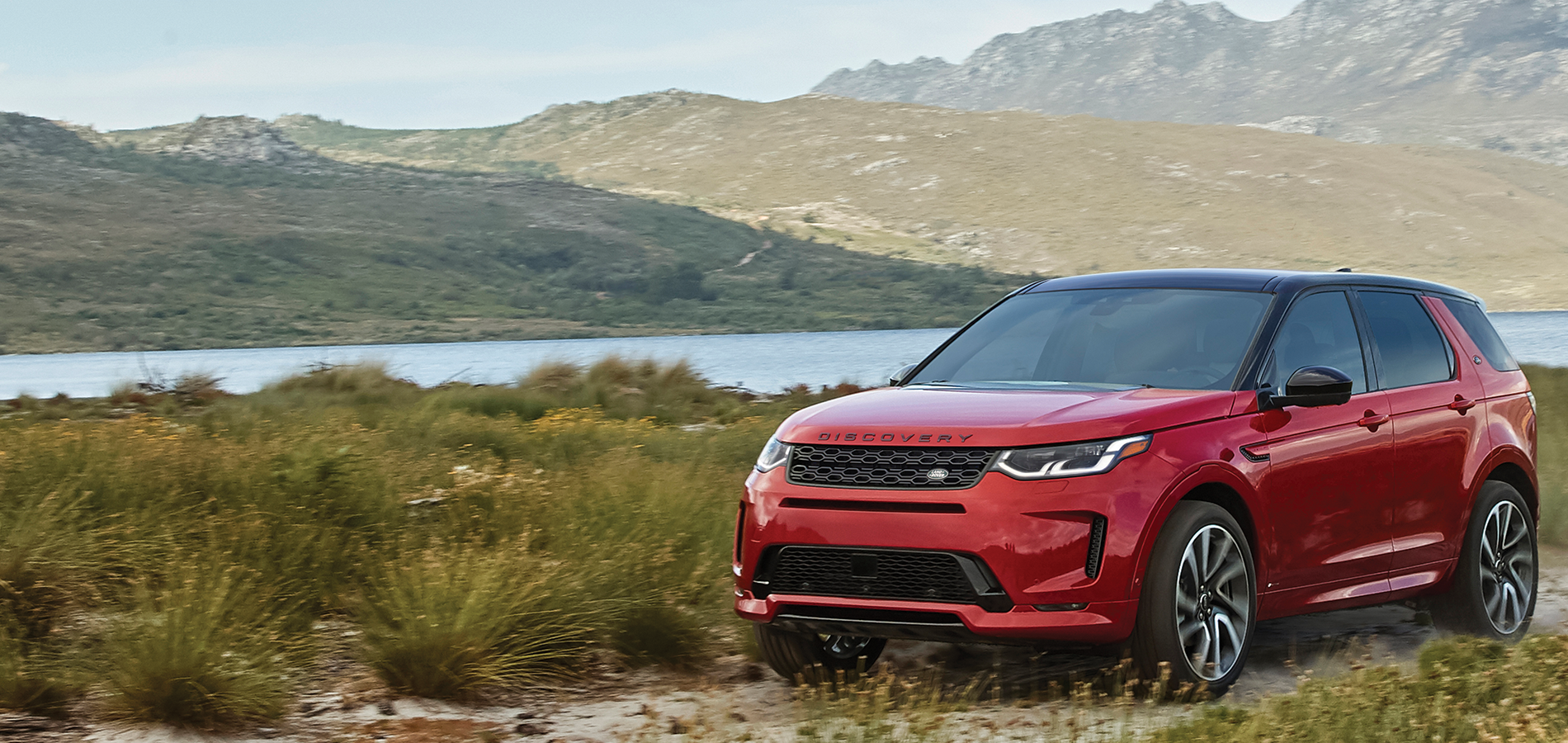 Red Discovery Sport in marshland
