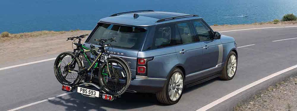 Land Rover Range Rover driving with bikes on rack