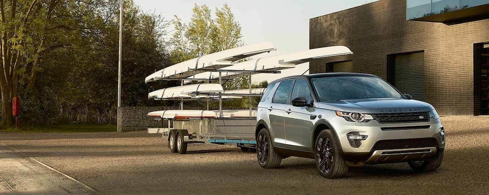 silver 2019 land rover discovery sport towing boats on a trailer