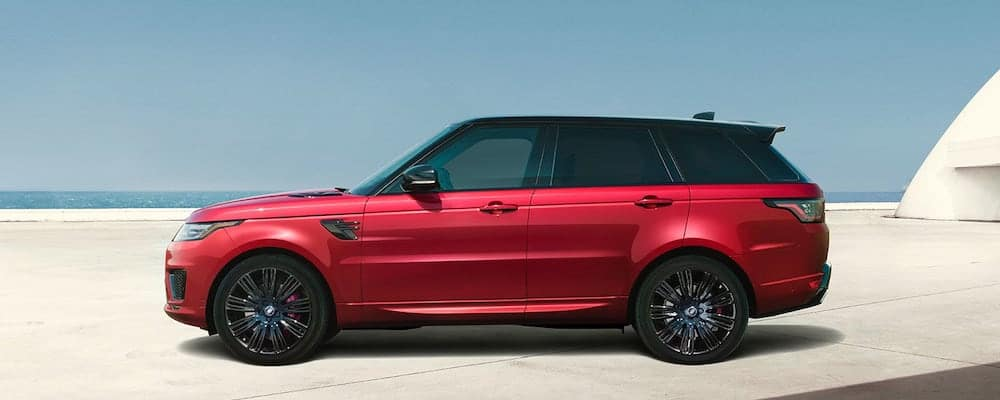 2019 Range Rover Sport Autobiography Dynamic in Firenze Red parked in concrete structure next to ocean