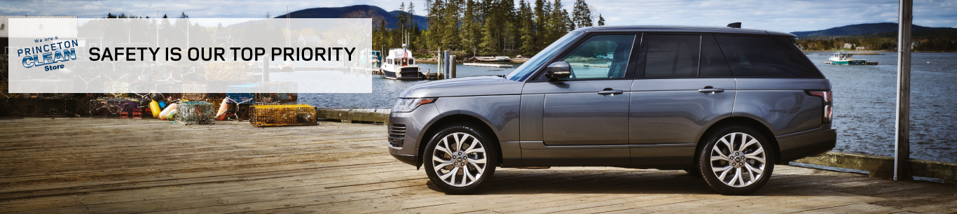 SAFETY IS OUR TOP PRIORITY. BLUE RANGE ROVER PARKED ON FISHING DOCK.