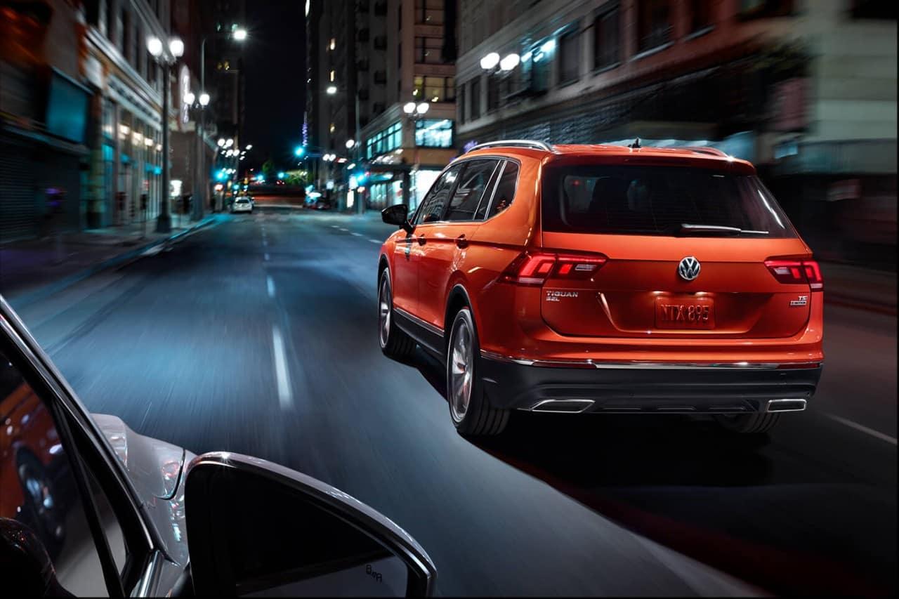 Back of an Orange Volkswagen Tiguan SUV on a City Street