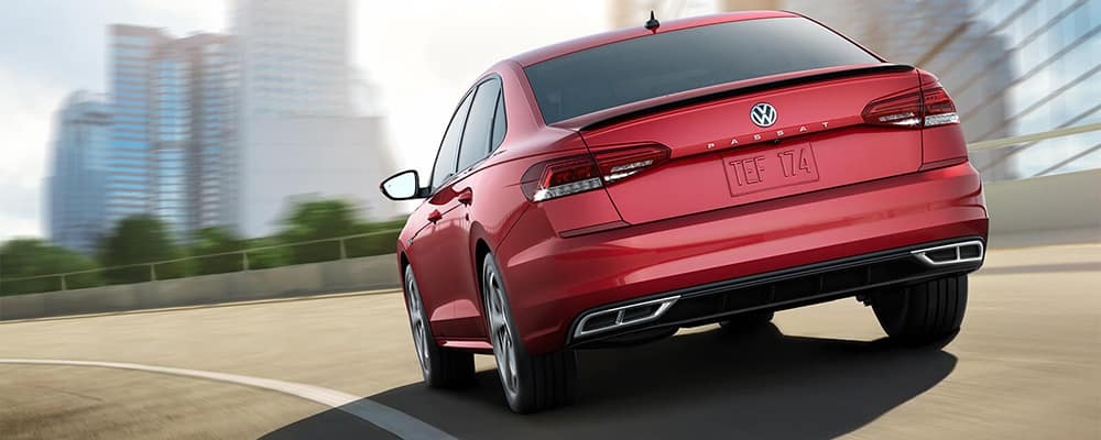 red passat driving on highway