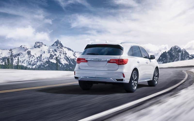 2019 Acura MDX driving on snowy roads