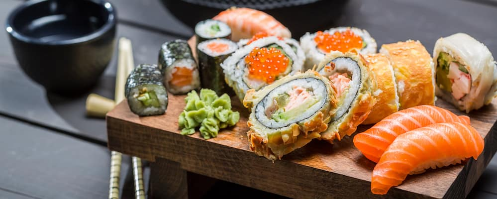 Spread of sushi on a modern wooden plate