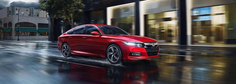 2018 honda accord red exterior driving down road in rain