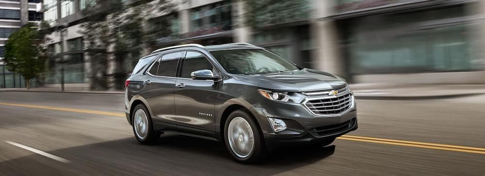 2019 chevy equinox silver exterior driving down road