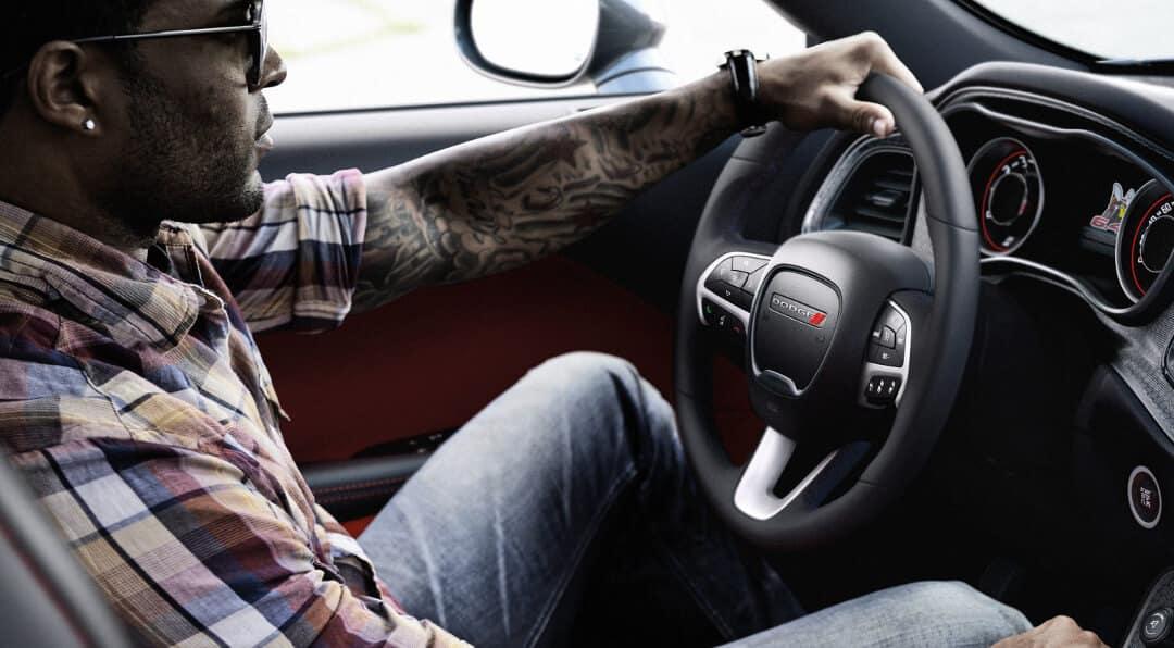 Man driving Dodge Challenger