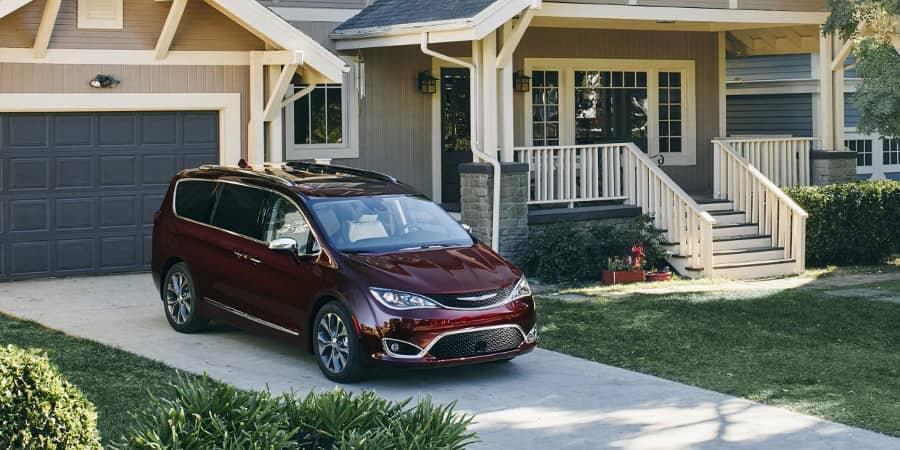 2018 Chrysler Pacifica parked in front of garage