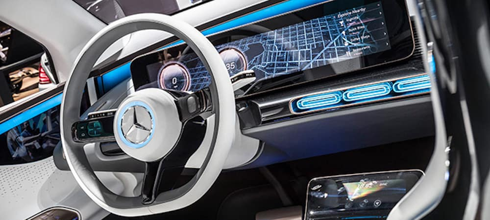 Inside of a Mercedes-Benz with a digital instrument cluster