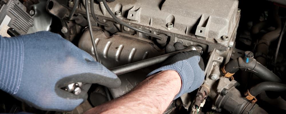 Technician performing mechanical repairs