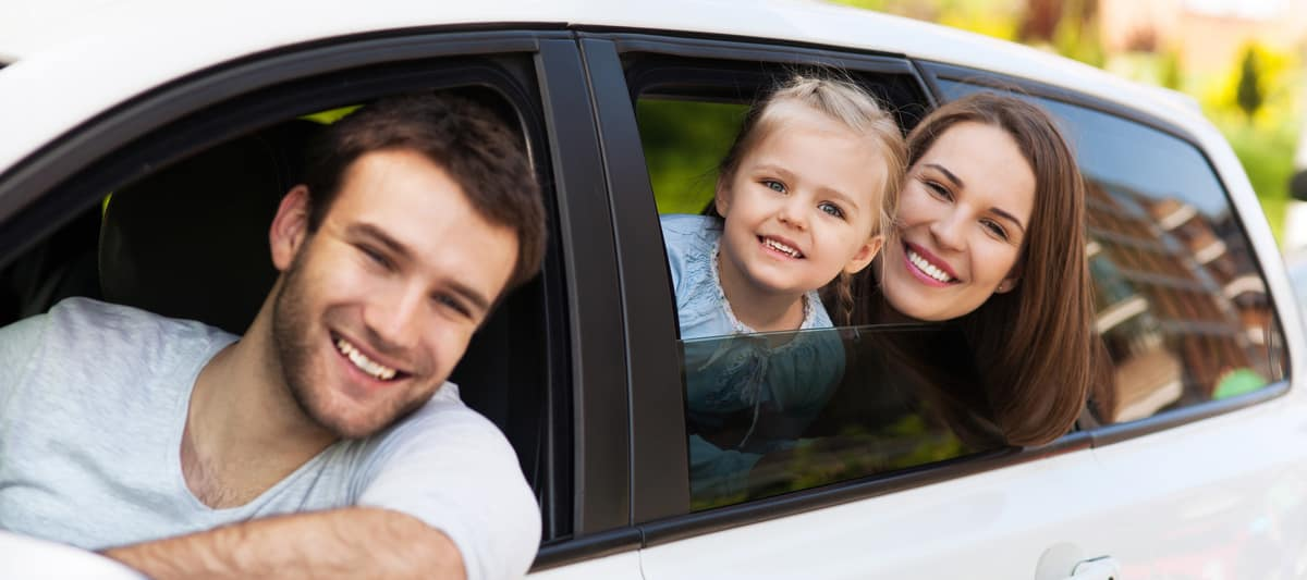 Family Driving Newly Bought Car