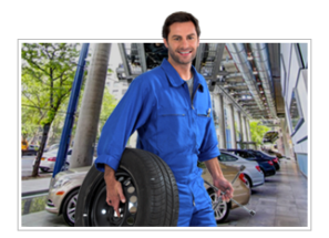 Mechanic Holding tire