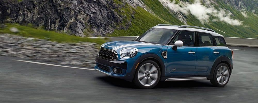 Blue MINI Cooper on road