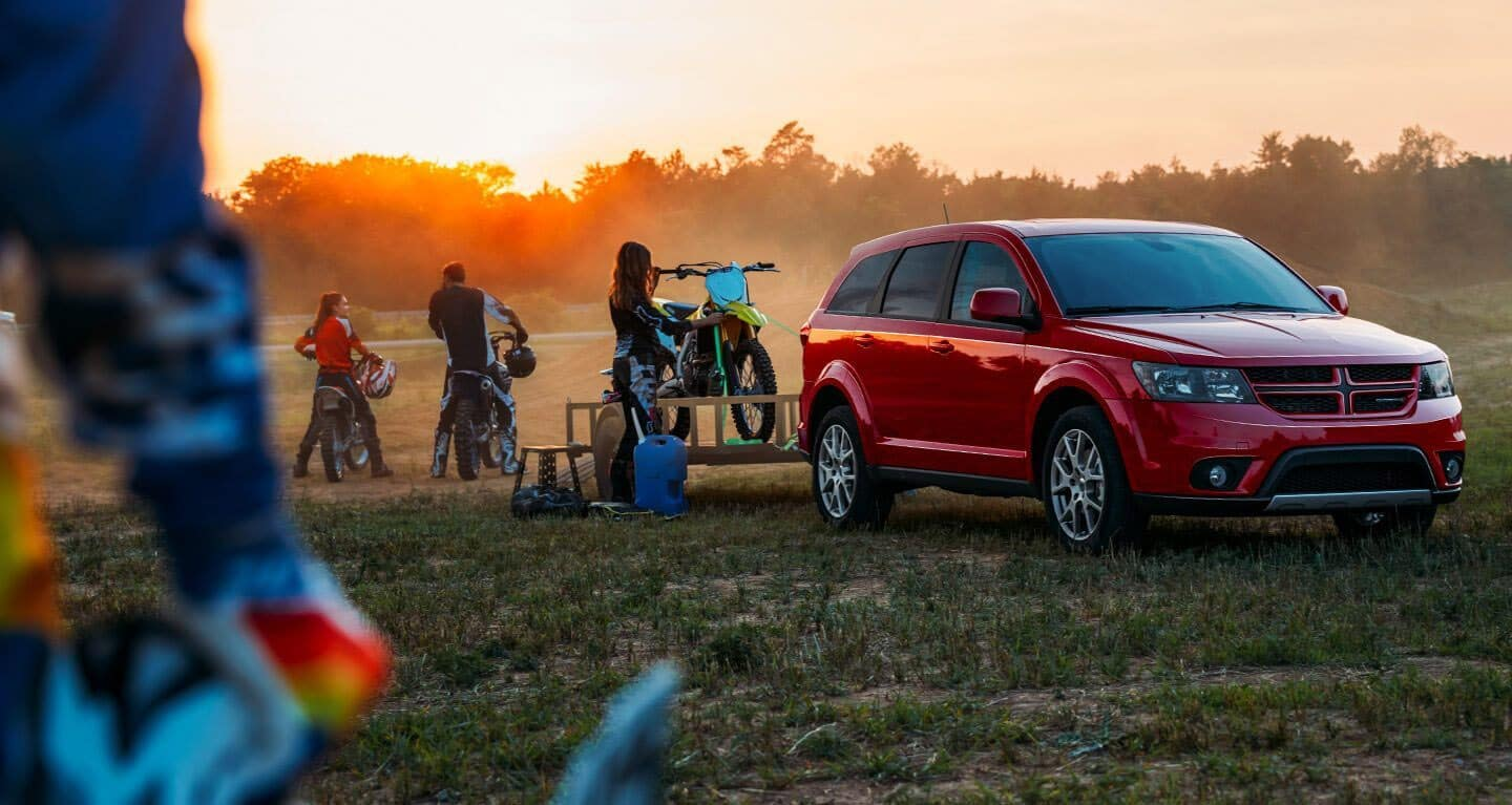 2019 Dodge Journey with family and motorcycles
