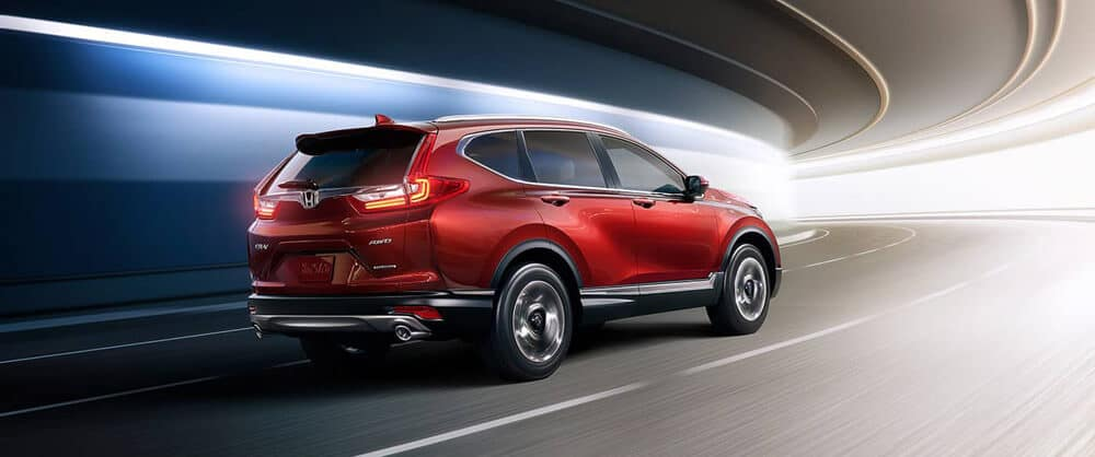 A red 2018 Honda CR-V driving through a tunnel around a corner