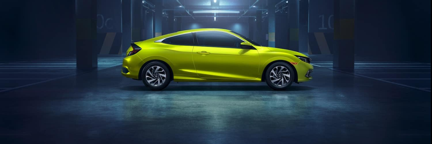 A green 2019 Honda Civic parked in a parking garage