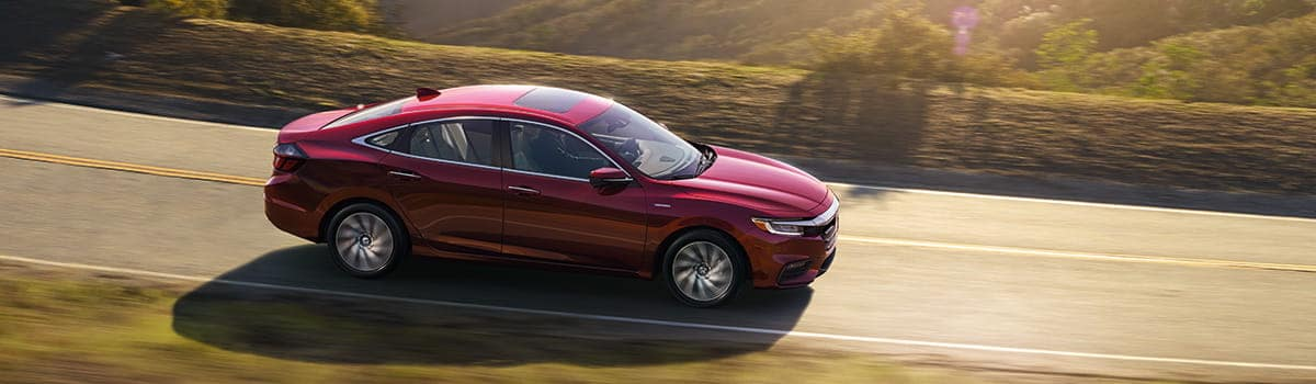 2019 Red Honda Insight exterior sideview driving