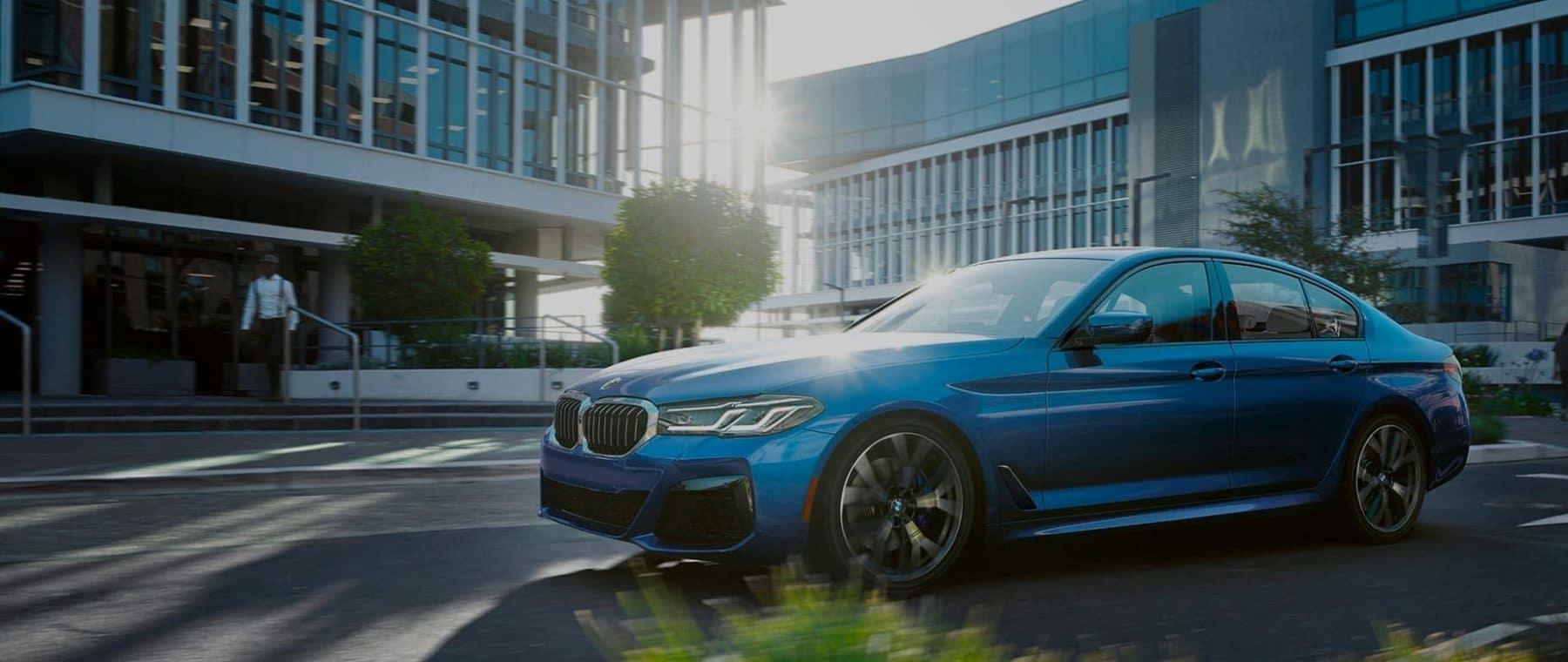 Blue BMW Shining in Sunlight