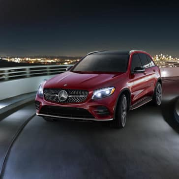 Red 2018 Mercedes-Benz GLC driving on a road at night