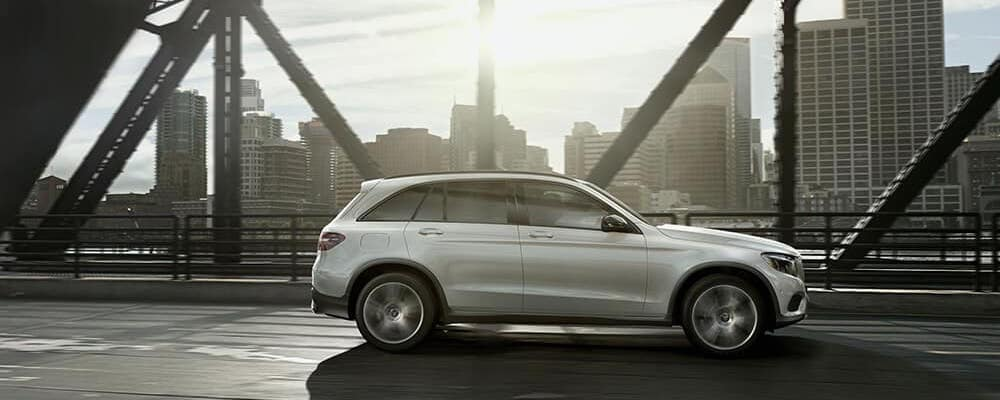 Silver Mercedes-Benz GLC driving on a bridge