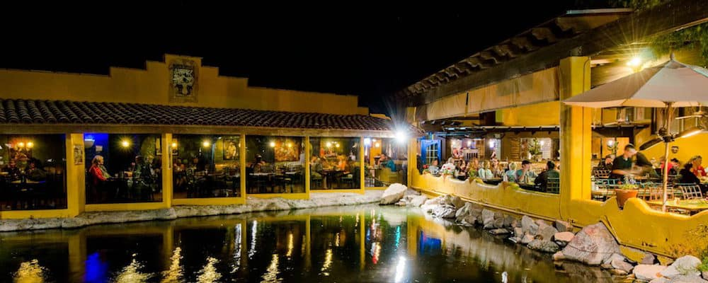 El Encanto Mexican restaurants outdoor patio next to a pond