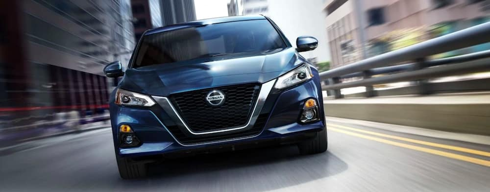2019 Nissan Altima in blue on city streets