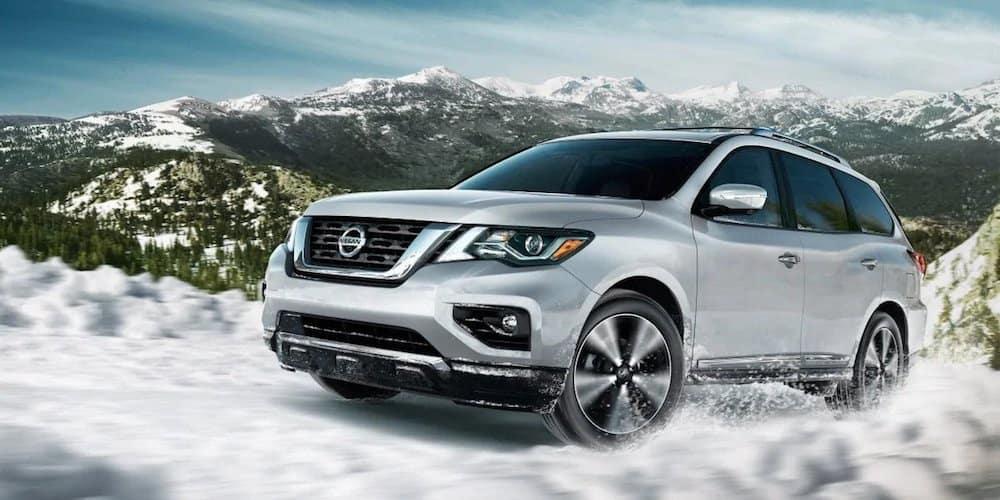 Silver 2019 Nissan Pathfinder on Snowy Road