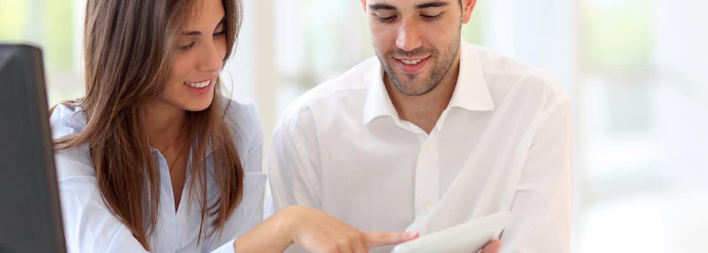 young couple using touchpad together