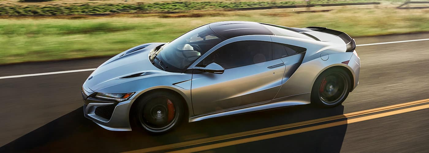 2019 acura nsx driving down highway