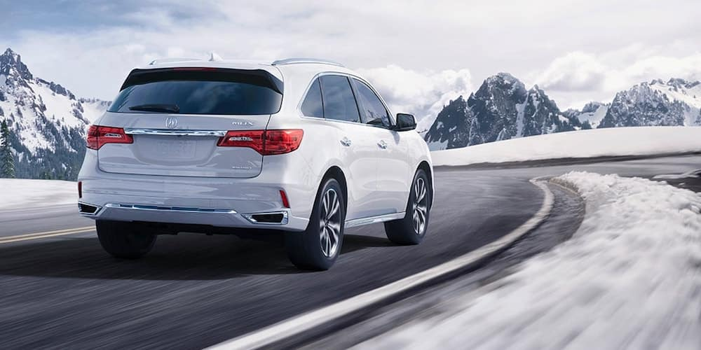 White 2020 Acura MDX on Snowy Road