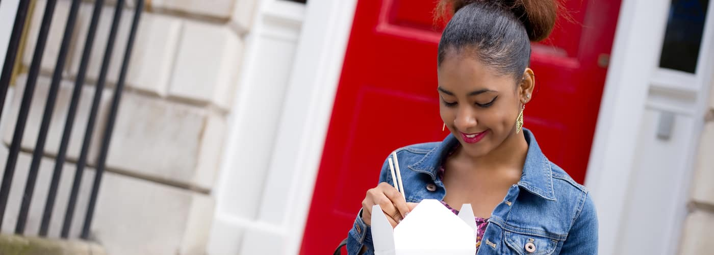 Young Woman Enjoying Takeout Food