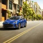 Blue 2017 Toyota Corolla driving down the street